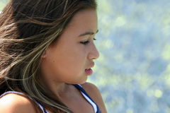 Profile of a beautiful girl stock images