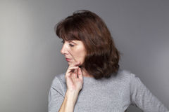 Profile of a beautiful 50s woman in reflection Royalty Free Stock Images