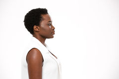 Profile of beautiful serious african american woman with short haircut. Profile of beautiful serious african american young woman with short haircut over white Stock Images