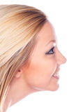 Profile of the beautiful smiling girl looking up Stock Images