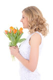 Profile of beautiful woman with bouquet of orange tulips isolate Stock Photography