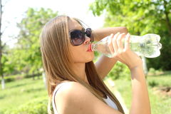 Profile of beautiful woman drink some water Stock Photos