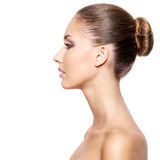 Profile of a beautiful woman with fresh clean skin. Profile of a young beautiful woman with fresh clean skin, isolated on white Royalty Free Stock Photography
