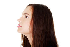 Profile of beautiful woman looking up. Royalty Free Stock Images