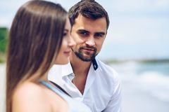 Profile of beautiful woman standing before a respectable bearded man. Profile of a beautiful women  standing before a respectable bearded man stock photos