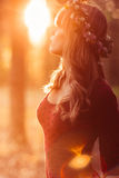 Profile of beautiful woman in wreath, sunset flare Stock Images