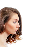 Profile of a beautiful young woman with evening make-up Stock Photography