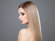 Profile of a beauty with long straight hair Royalty Free Stock Image