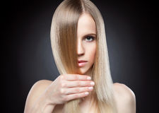 Profile of a beauty with long straight hair Royalty Free Stock Photos