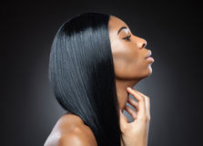 Profile of a black beauty with perfect straight hair Royalty Free Stock Image