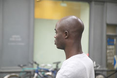 Profile of black man walking down street, Paris, France royalty free stock photos