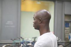 Profile of black man walking down street, Paris, France Royalty Free Stock Photos
