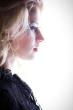 profile blond girl thinking Royalty Free Stock Image