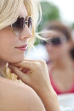 Profile of Blond Woman in Heart Shaped Sunglasses Royalty Free Stock Image
