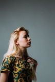 Profile of a blonde young woman, with her eyes closed Royalty Free Stock Photography