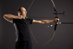 Profile of bowman with bow and arrow. Royalty Free Stock Images