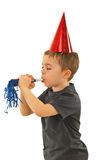 Profile of boy blowing noise maker Stock Image