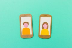 Profile of boy and girl on smartphone Royalty Free Stock Image
