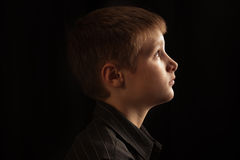 Profile of a boy Stock Images
