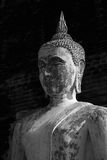 Profile of Buddha statue. Profile of ancient Buddha statue in black Stock Photos