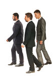 Profile of business men walking Stock Photography