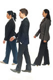 Profile of business people walking Stock Image