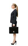 Profile of business woman with suitcase Royalty Free Stock Images