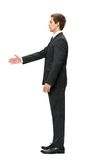 Profile of businessman handshaking. Profile of businessman handshake gesturing, isolated on white. Concept of leadership and success Royalty Free Stock Image