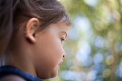 Profile child female face with bokeh background Royalty Free Stock Photo