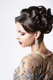 Profile of Classy Brown Hair Lady with Jewelry and Festive Hairstyle Royalty Free Stock Photo