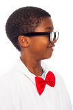 Profile of clever scientist child. Profile of happy clever school boy in scientist lab coat, red bow tie and black eyeglasses, isolated on white background Royalty Free Stock Photos