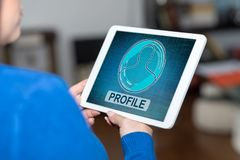Profile concept on a tablet. Tablet screen displaying a profile concept royalty free stock image