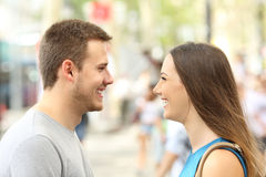 Profile of couple looking each other falling in love. On the street royalty free stock image