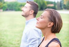 Couple of man and woman breathing deep fresh air together in the Royalty Free Stock Photo