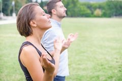 Profile of a couple of man and woman meditating together in the. Profile of a couple of men and women meditating in the nature Royalty Free Stock Image