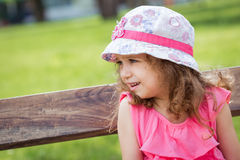 Profile of cute little girl in a park Royalty Free Stock Photo