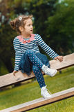 Profile of cute little girl in a park Royalty Free Stock Image