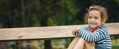 Profile of cute little girl in a park Royalty Free Stock Photography