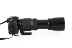 Profile of digital SLR with long telephoto lens Stock Photography