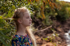 Profile of dreamy young girl posing with tree Royalty Free Stock Photos