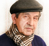 Profile of elderly man with scarf Stock Images