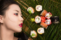 Profile face beautiful young Korean girl with rolls. From above Royalty Free Stock Photo