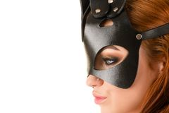 Profile face submissive woman in mask BDSM closeup. Isolated on white background stock image