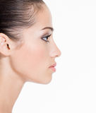 Profile face of a young woman stock image