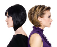 Profile faces of two attractive adult girls royalty free stock photos