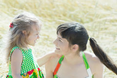 Profile family portrait of cheerful woman and her little daughter face to face outdoors Stock Images