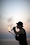 Profile of fire-breathing performer drinking water Royalty Free Stock Photos