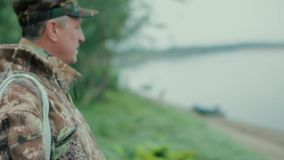 A fisherman by the river. Profile of a fisherman close-up on a motor boat background stock video footage