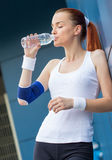 Profile of fit activity woman drinking water Royalty Free Stock Photos