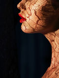 Profile of Futuristic Woman's Face with Openwork Lace in Shadows. Side view or a Girl with Openwork Lace Royalty Free Stock Photo